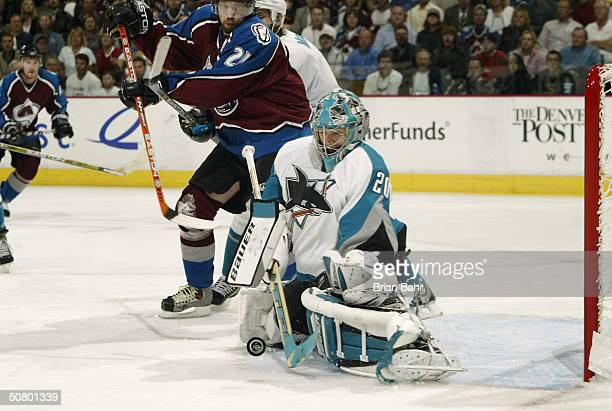 Peter Forsberg of the Colorado Avalanche can't turn a play from behind the net into a goal against goalie Evgeni Nabokov of the San Jose Sharks in...