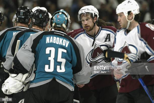 Peter Forsberg of the Colorado Avalanche shakes hands with goalie Evgeni Nabokov of the San Jose Sharks after game seven of the Western Conference...