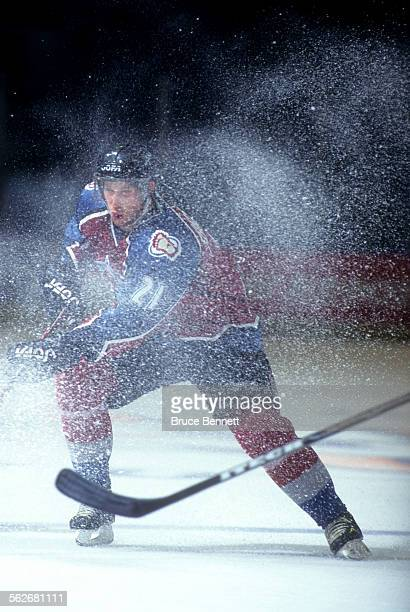 Peter Forsberg of the Colorado Avalanche skates thru snow on the ice during an NHL game against the New York Islanders on November 11, 1996 at the...