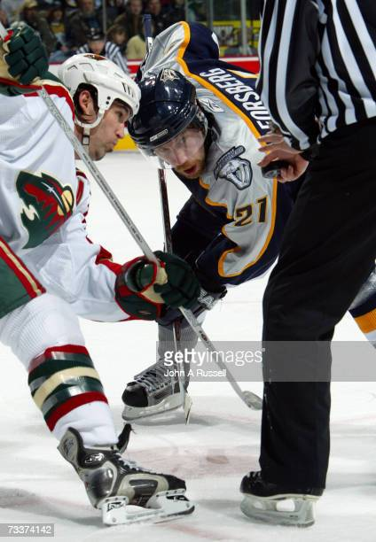Peter Forsberg the Nashville Predators faces off against Brian Rolston of the Minnesota Wild at Gaylord Entertainment Center on February 17, 2007 in...