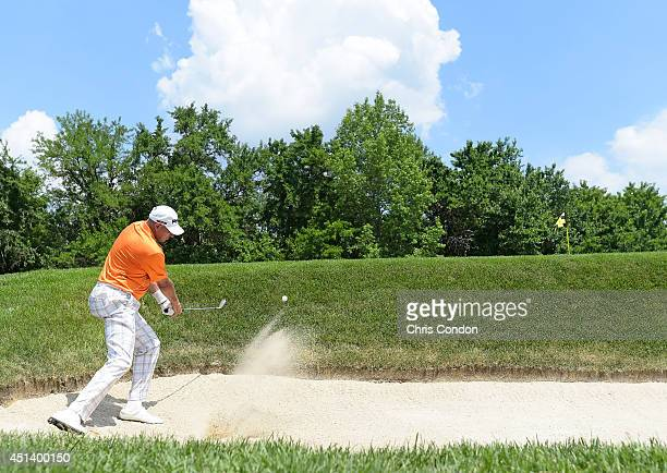 Peter Fowler of Australia hits from a bunker on the 10th hole during the third round of the Constellation SENIOR PLAYERS Championship at Fox Chapel...