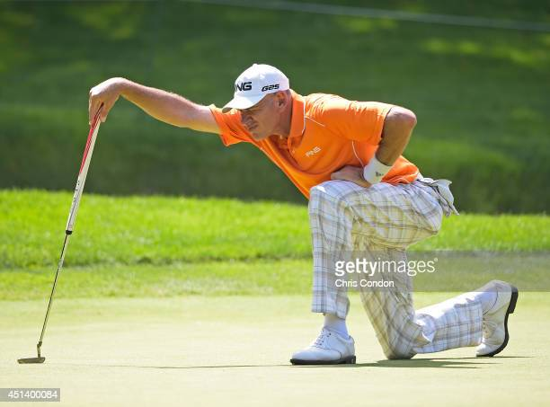 Peter Fowler of Australia lines up a putt on the 13th green during the third round of the Constellation SENIOR PLAYERS Championship at Fox Chapel...