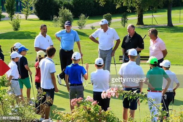 Peter Fowler of Australia Ronan Rafferty of Northern Ireland Barry Lane of England and Roger Chapman of England host a junior clinic after the first...