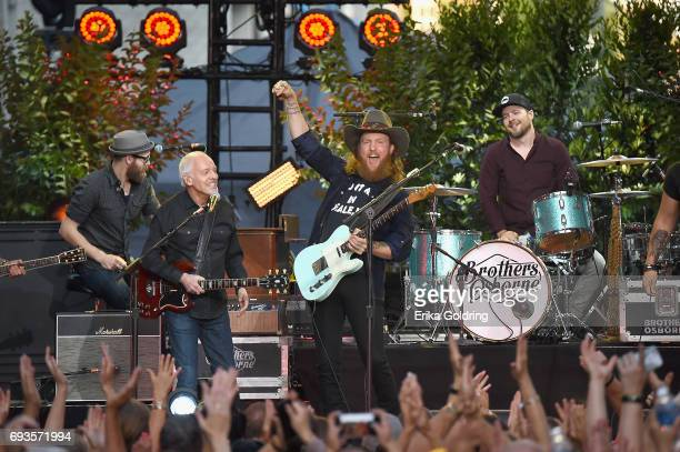 Peter Frampton and John Osborne of Brothers Osborne perform onstage at the 2017 CMT Music awards at the Music City Center on June 7 2017 in Nashville...