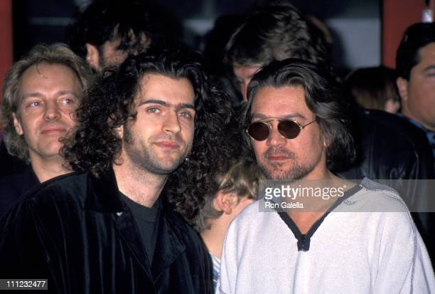 Peter Frampton Dweezil Zappa and Eddie Van Halen during Jimmy Page Induction into Hollywood RockWalk of Fame at Guitar Center in Hollywood California...