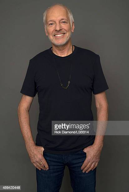 Peter Frampton poses backstage at One More For The Fans Celebrating the Songs Music of Lynyrd Skynyrd at The Fox Theatre on November 12 2014 in...