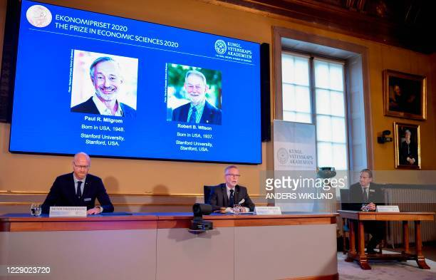 Peter Fredriksson, Chairman of the Committee for Economic Sciences, Goran K. Hansson, Permanent Secretary for the Royal Swedish Academy of Sciences...
