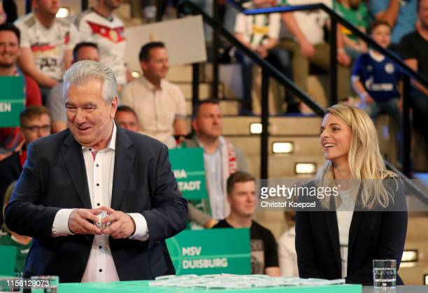 Peter Frymuth head of DFB Cup Draw and vicepresident of DFB and Nia Kuenzer former player of Germany during the DFB Cup 2019/20 First Round Draw at...