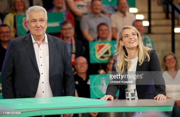 Peter Frymuth head of DFB Cup Draw and vicepresident of DFB and Nia Kuenzer former player of Germany react during the DFB Cup 2019/20 First Round...