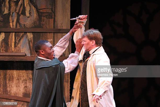 """Peter Furlong performs the role of Mario Cavaradossi and Brandon Coleman performs the role of Angelotti in """"Tosca"""" perform on Opening Night at the..."""