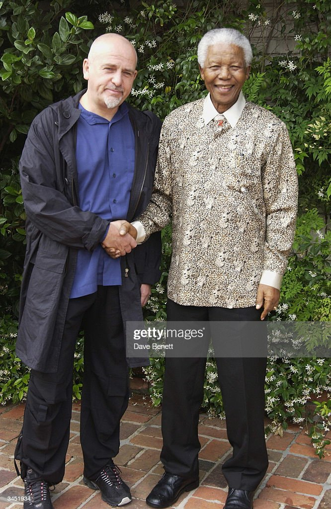 Peter Gabriel and Nelson Mandela attend Nelson Mandela's Pre Concert '46664' event at his home in the hills on November 27, 2003 in Cape Town.