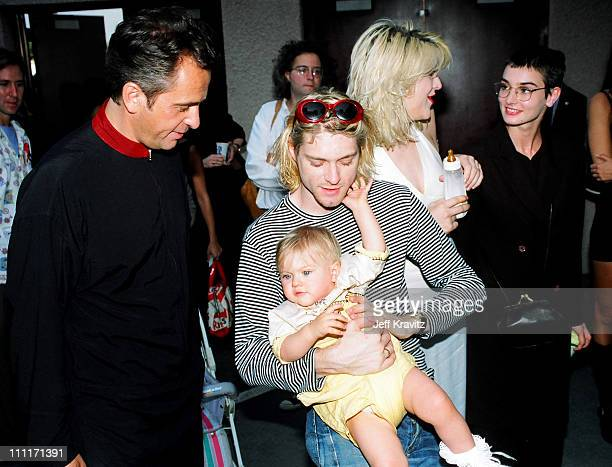 Peter Gabriel Kurt Cobain of Nirvana with wife Courtney Love and daughter Frances Bean Cobain and Sinead O'Connor