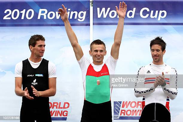 Peter Galambos of Hungary poses with second placed Duncan Grant of New Zealand and third placed Are Strandli of Norway after winning the men's...