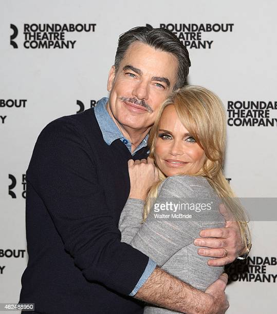 Peter Gallagher and Kristin Chenoweth attend the cast photocall for the Roundabout Theatre Company's Broadway production of 'On The 20th Century' at...