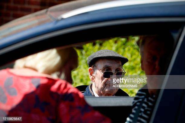 Peter Garrett speaks with relatives through their window during a drive-through visit at Gracewell, a residential care home in Adderbury near...