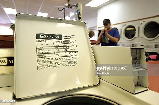 Peter Georgitsis folds clothes at a Maytag laundromat May 11 2006 in Mount Prospect Illinois Whirlpool reportedly may be closing three Maytag...