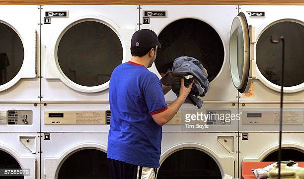 Peter Georgitsis reaches into a Maytag commercial dryer for his clothing at a Maytag laundromat May 11 2006 in Mount Prospect Illinois Whirlpool...