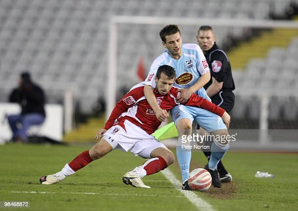 Peter Gilbert of Northampton Town gets to grips with Adam Le Fondre of Rotherham United during the Coca Cola League Two Match between Rotherham...