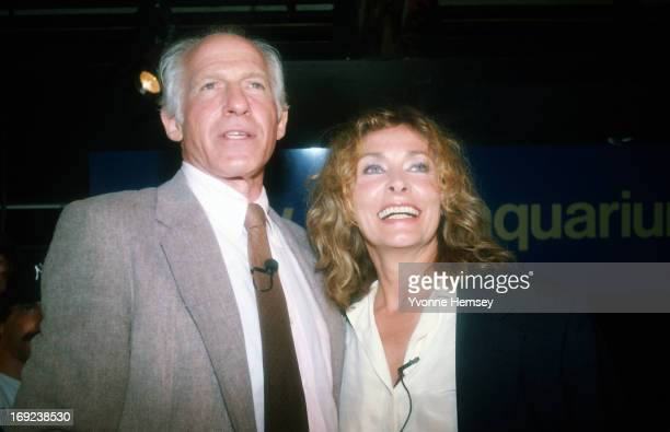 Peter Gimbel and his wife Elga Andersen are photographed August 16 1984 at the Brooklyn Aquarium in Brooklyn New York as they wait for the opening of...