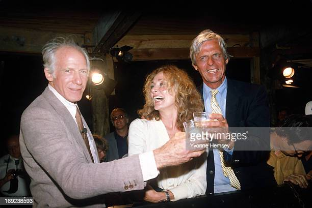 Peter Gimbel his wife Elga Andersen and George Plimpton the television host of the 'Opening of the Andrea Doria's safe' are photographed toasting the...