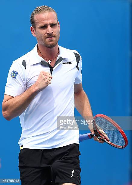 Peter Gojowczyk of Germany celebrates a point in his first round match against Guillermo GarciaLopez of Spain during day two of the 2015 Australian...