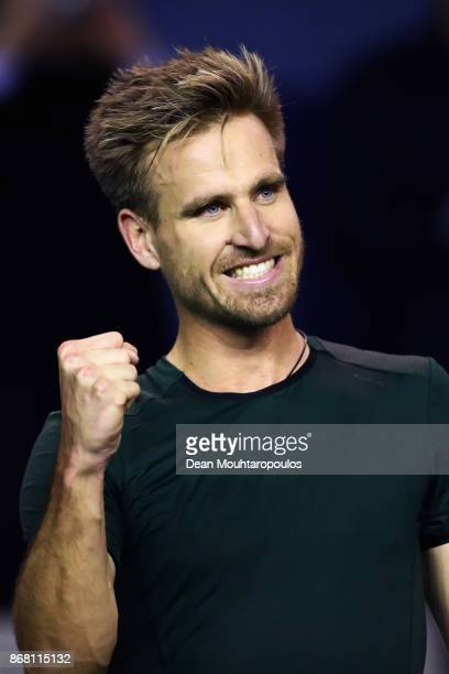 Peter Gojowczyk of Germany celebrates victory over Ryan Harrison of the USA during Day 1 of the Rolex Paris Masters held at the AccorHotels Arena on...
