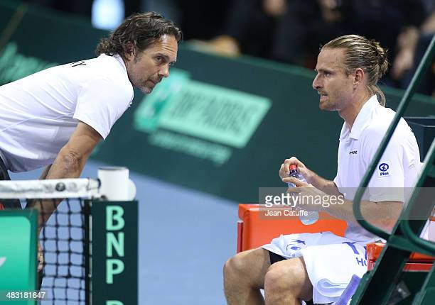 Peter Gojowczyk of Germany listens to german Davis Cup captain Carsten Arriens during the second round Davis Cup match between France and Germany at...