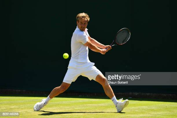 Peter Gojowczyk of Germany plays a backhand during the Gentlemen's Singles second round match against Roberto Bautista Agut of Spain on day three of...