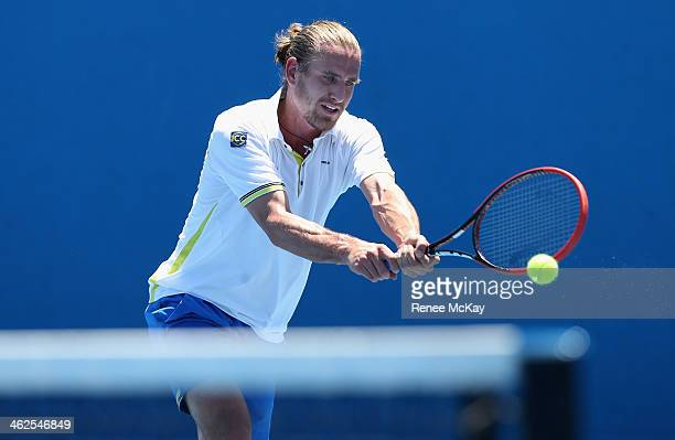 Peter Gojowczyk of Germany plays a backhand in his first round match against Victor Hanescu of Romania during day two of the 2014 Australian Open at...