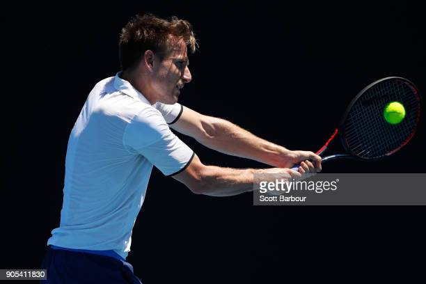 Peter Gojowczyk of Germany plays a backhand in his first round match against Mikhail Kukushkin of Kazakhstan on day two of the 2018 Australian Open...