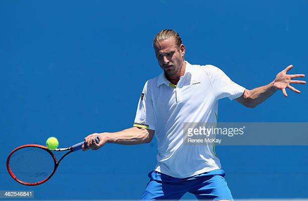 Peter Gojowczyk of Germany plays a forehand in his first round match against Victor Hanescu of Romania during day two of the 2014 Australian Open at...