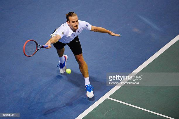 Peter Gojowczyk of Germany plays a forehand in his match against Gael Monfils of France during day 3 of the Davis Cup Quarter Final match between...