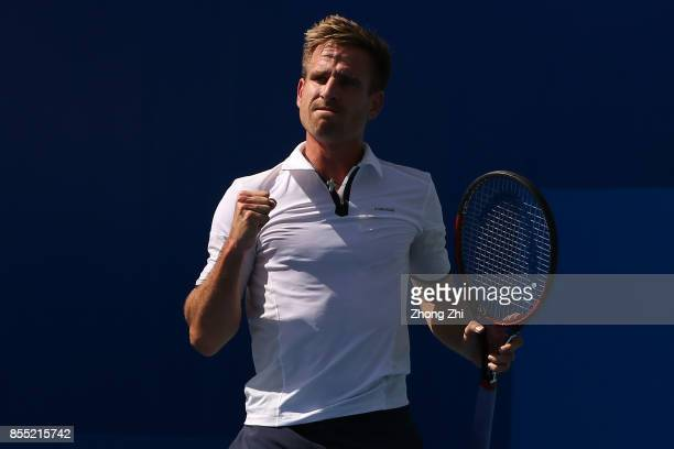 Peter Gojowczyk of Germany reacts during the match against Marcos Baghdatis of Cyprus during Day 4 of 2017 ATP Chengdu Open at Sichuan International...