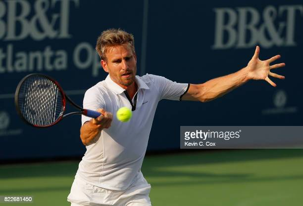Peter Gojowczyk of Germany returns a forehand to Guido Pella of Argentina during the BBT Atlanta Open at Atlantic Station on July 25 2017 in Atlanta...