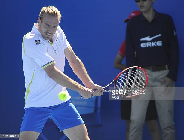 Peter Gojowczyk of Germany returns a shot against Maximo Gonzalez of Argentina during day one of the China Open at the China National Tennis Center...