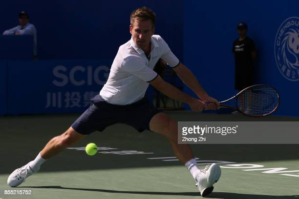 Peter Gojowczyk of Germany returns a shot during the match against Marcos Baghdatis of Cyprus during Day 4 of 2017 ATP Chengdu Open at Sichuan...