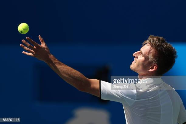 Peter Gojowczyk of Germany serves during the match against Marcos Baghdatis of Cyprus during Day 4 of 2017 ATP Chengdu Open at Sichuan International...