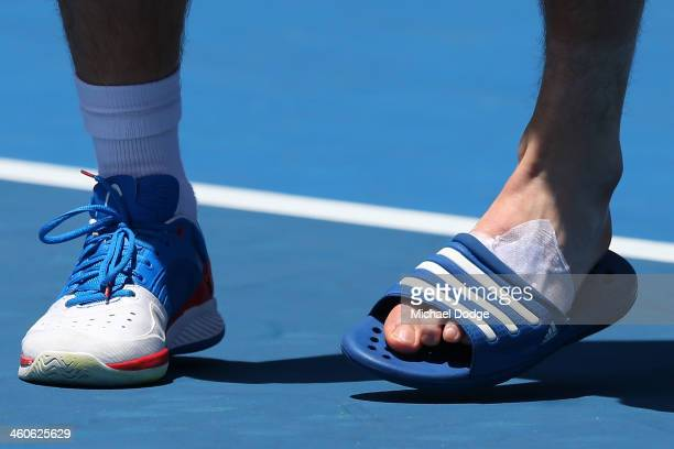 Tennis foot stock photos and pictures getty images peter gojowczyk of germany trains with a thong on one foot ahead of the 2014 australian voltagebd Image collections