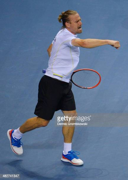 Peter Gojowzyk of Germany celebrates after winning his match against Jo-Wilfried Tsonga of France during day 1 of the Davis Cup Quarter Final match...