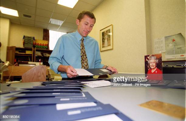 Peter Golden a Telegraph Clerk in the Post Office at Buckingham Palace the official residence of Queen Elizabeth II prepares the personalised 100th...