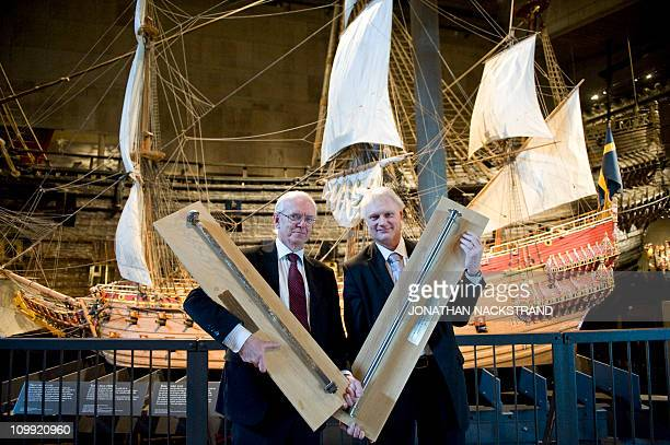 Peter Gossas head of Sandvik Materials Technology and Rober Olsson head of the National Maritime Museums hold the old iron bolts and the new highly...