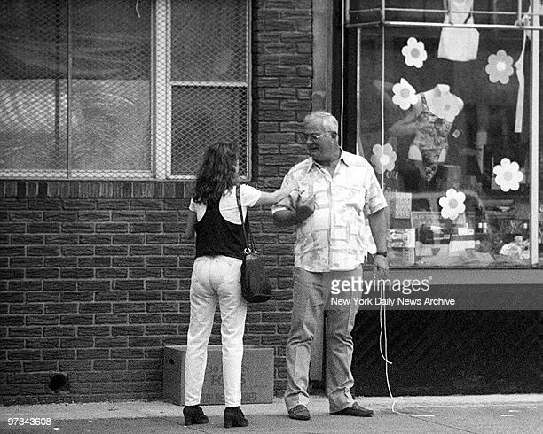 Peter Gotti talks to a woman in front of the Bergin Hunt and Fish Social Club