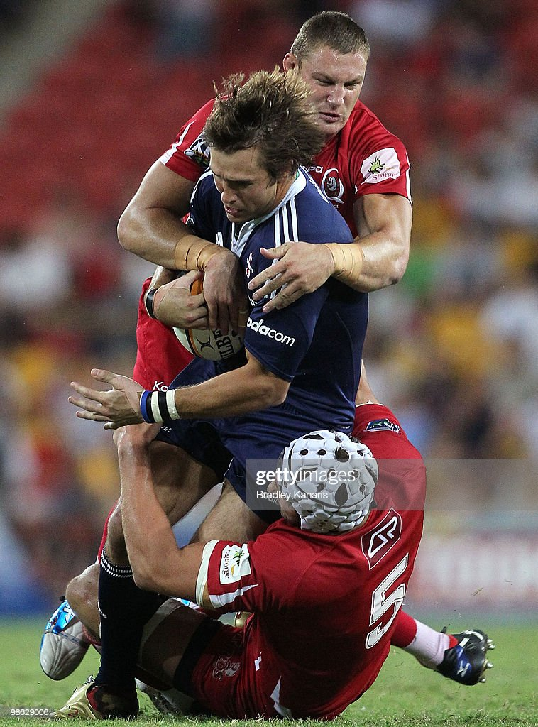 Peter Grant of the Stormers takes on the Reds defence during the round eleven Super 14 match between the Reds and the Stormers at Suncorp Stadium on April 23, 2010 in Brisbane, Australia.
