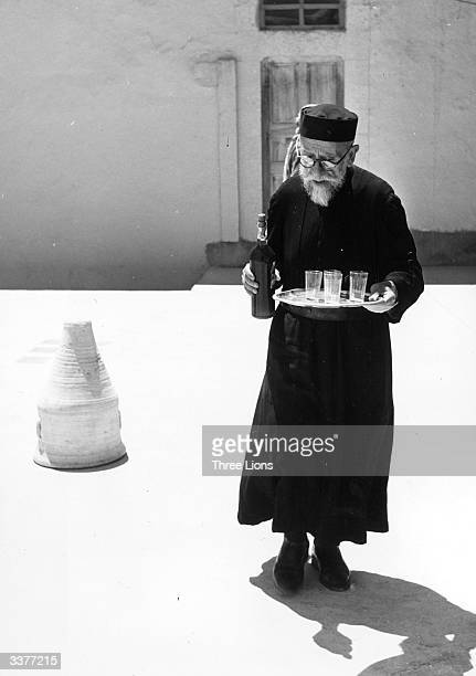 Peter Gregoire of the Greek Catholic monastery of Mar Sarkis in the Syrian village of Maaloula with a bottle of the monastery's wine