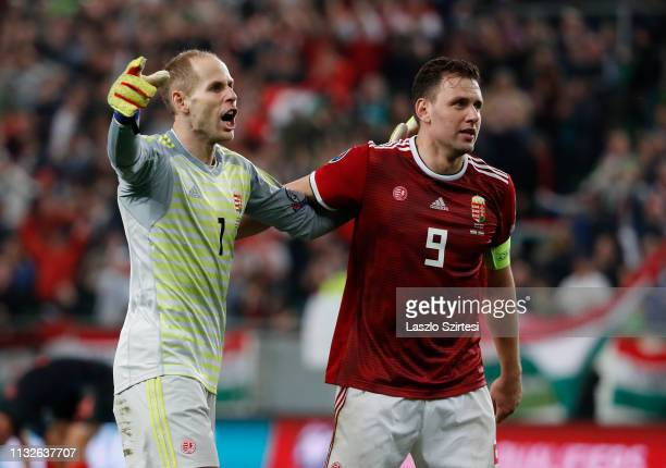 Peter Gulacsi of Hungary celebrates victory with teammate Adam Szalai during the 2020 UEFA European Championships group E qualifying match between...