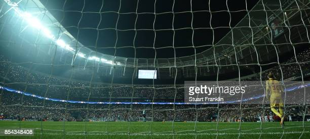 Peter Gulacsi of Leipzig walks from his goal as half of the stadium lights go out causing a delay during the UEFA Champions League second leg group G...