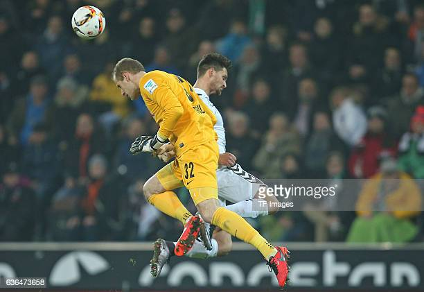 Peter Gulacsi of RB Leipzig and Enis Alushi of St Pauli battle for the ball during the Second Bundesliga match between FC St Pauli and RasenBallsport...