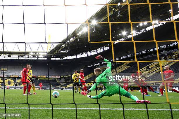 Peter Gulacsi of RB Leipzig fails to save as Jadon Sancho of Borussia Dortmund scores his team's second goal during the Bundesliga match between...