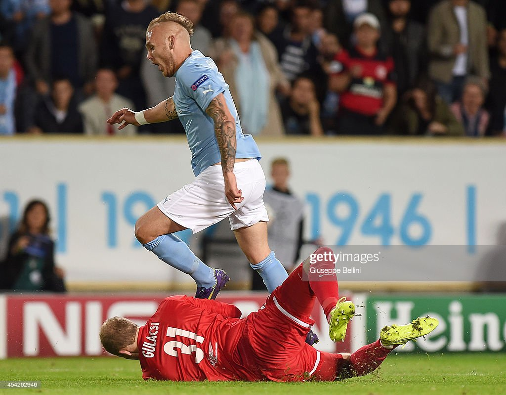 Peter Gulacsi of Red Bull Salzburg and Magnus Erksson of Malmo in action during UEFA Champions League qualifying play-offs round second leg match between Malmo FF and Red Bull Salzburg on August 27, 2014 in Malmo, Sweden.