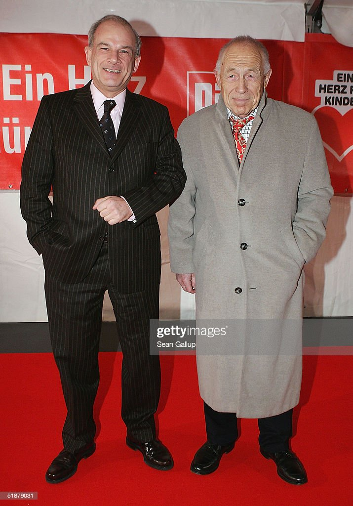 Peter Hahne (left) and Heiner Geissler arrive at the 'Ein Herz Fuer Kinder' Gala on December 18, 2004 at The Axel Springer building in Berlin, Germany.
